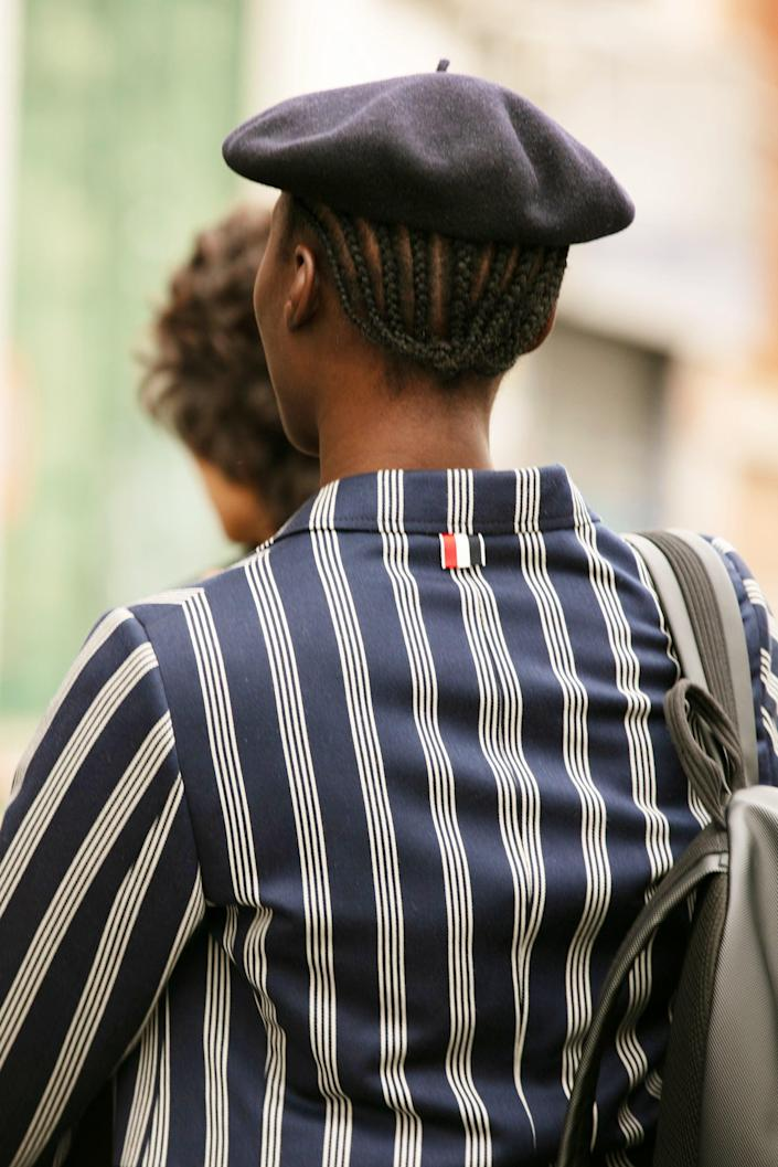 """Straight-back braids will always be  stylish, but even more so with a beret. <em>C'est chic! </em> <span class=""""copyright"""">Photographed by Hannan Saleh.</span>"""