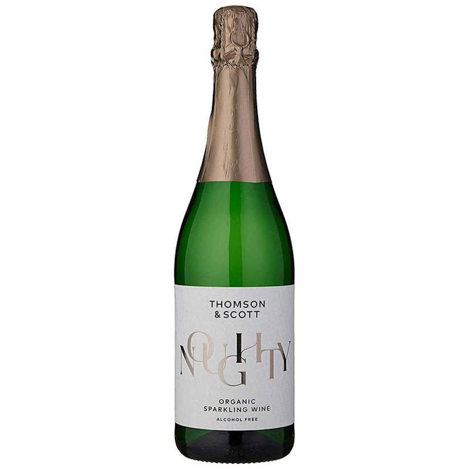 """<p>Thomson & Scott's alcohol-free bubbly is the perfect way to participate in a New Year's Eve toast while skipping the standard sparkling-induced hangover. Made from 100% Organic Chardonnay grapes sourced from Spain, the expert taste testers of No & Low describe Noughty's palette as """"medium-dry, crispy ripe apples, lots of fine bubbles, fruity with hints of sweetness to finish."""" </p> <p><strong>Buy It! </strong>$21.99, <a href=""""https://drinknolow.com/collections/shop-all-products/products/noughty-organic-sparkling-wine"""" rel=""""nofollow noopener"""" target=""""_blank"""" data-ylk=""""slk:drinknolow.com"""" class=""""link rapid-noclick-resp"""">drinknolow.com</a></p>"""