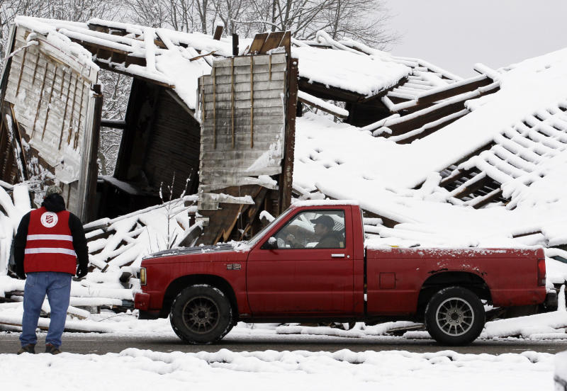 A resident drives around a house left damaged by Friday's tornado in Marysville, Ind., Monday, March 5, 2012. (AP Photo/Nam Y. Huh)