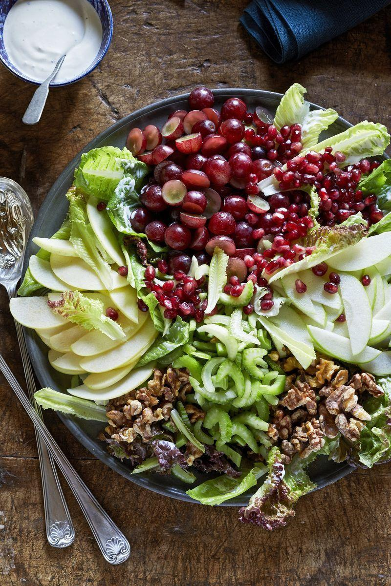 """<p>This old-fashioned Thanksgiving side dish gets a new life thanks to some smart prep! Organized sections let eaters choose what to include and what to leave out, and dressing on the side gives everyone a chance to add as much or little as they want.</p><p><strong><a href=""""https://www.countryliving.com/food-drinks/a29131841/composed-waldorf-salad/"""" rel=""""nofollow noopener"""" target=""""_blank"""" data-ylk=""""slk:Get the recipe"""" class=""""link rapid-noclick-resp"""">Get the recipe</a>.</strong> </p>"""