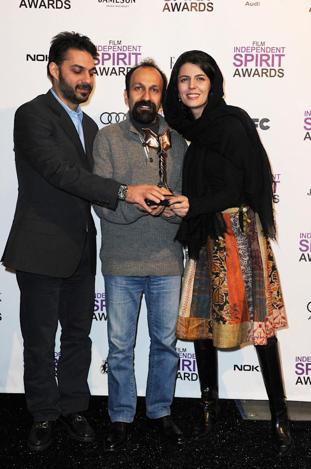 """SANTA MONICA, CA - FEBRUARY 25:  (L-R) Actor Peyman Maadi, director Asghar Farhadi and actress Leila Hatami pose with the award for Best International for """"A Separationt"""" in the press room at the 2012 Film Independent Spirit Awards on February 25, 2012 in Santa Monica, California.  (Photo by Frazer Harrison/Getty Images)"""