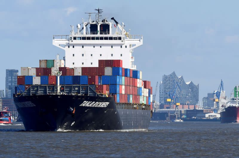 FILE PHOTO: FILE PHOTO: A container ship leaves the port in front of famous landmark Philharmonic Hall in Hamburg