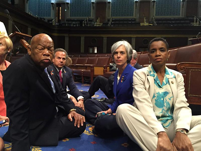 "A photo tweeted from the floor of the U.S. House by Rep. Donna Edwards (R) shows Democratic members of the U.S. House of Representatives, including herself and Rep. John Lewis (L) staging a sit-in on the House floor ""to demand action on common sense gun legislation"" on Capitol Hill in Washington on June 22, 2016. (Photo: Rep. Donna Edwards/Handout via Reuters)"