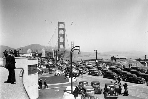 Media and cars at the Bridge on opening day. From the holdings of the Golden Gate Bridge, Highway and Transportation District, Used with Permission, www.goldengate.org