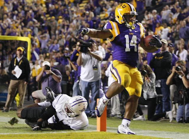 LSU running back Terrence Magee (14) runs past Furman safety Greg Worthy (32) for a 39-yard touchdown during the fourth quarter of the NCAA college football game in Baton Rouge, La., Saturday, Oct, 26, 2013. LSU won 48-16. (AP Photo/Jonathan Bachman)