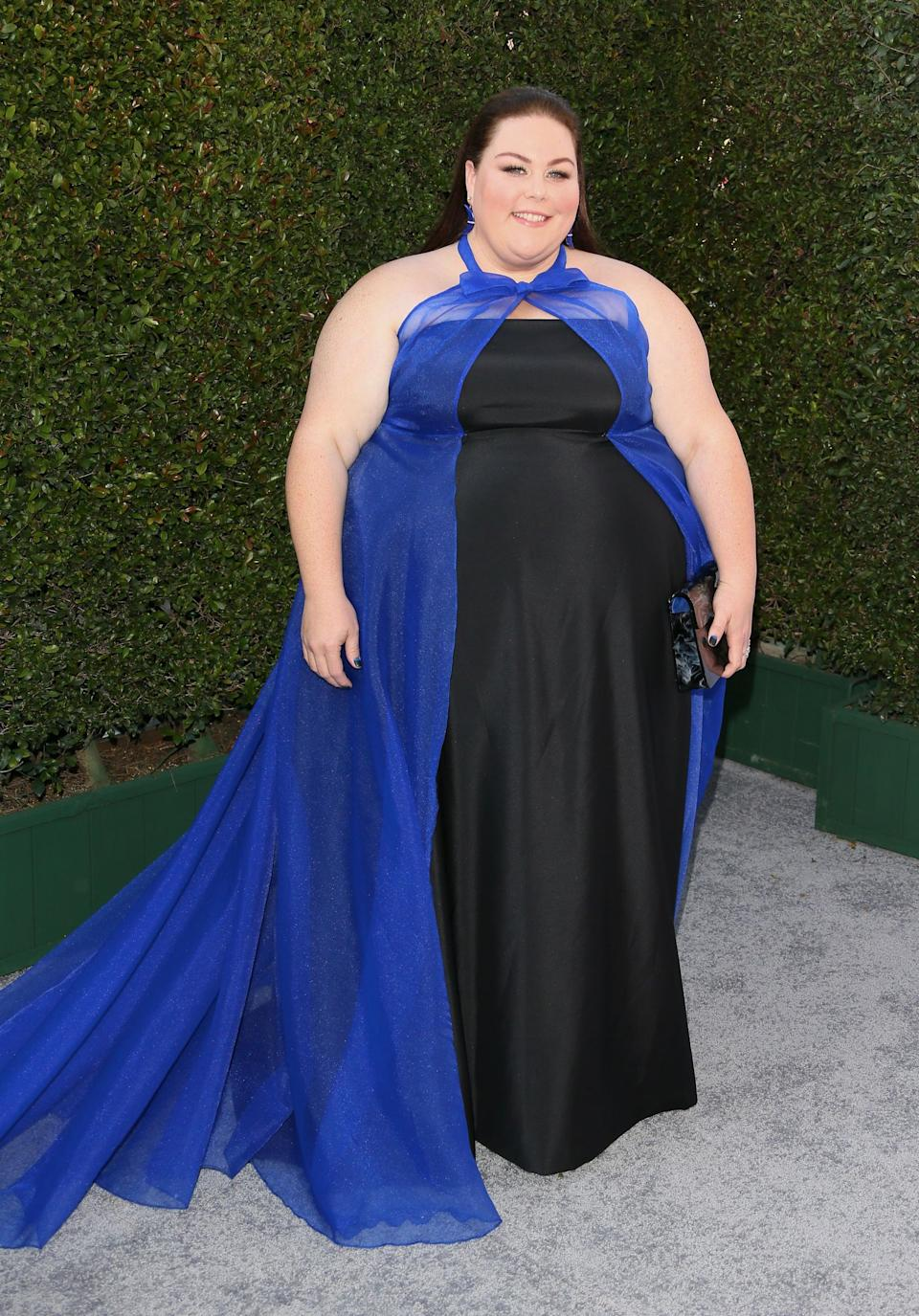 <p>Wearing a blue and black John Paul Ataker custom gown and cape with jewels by Andrea Fohrman, Graziela Gems, Sara Weinstock, and Melinda Maria. She finished her look off with Stuart Weitzman heels.</p>