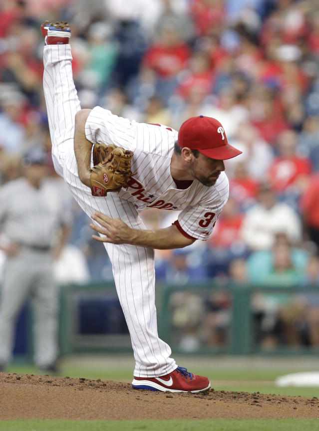 Philadelphia Phillies pitcher Cliff Lee throws in the first inning in a baseball game against the Colorado Rockies, Wednesday, Aug. 21, 2013, in Philadelphia. (AP Photo/Laurence Kesterson)