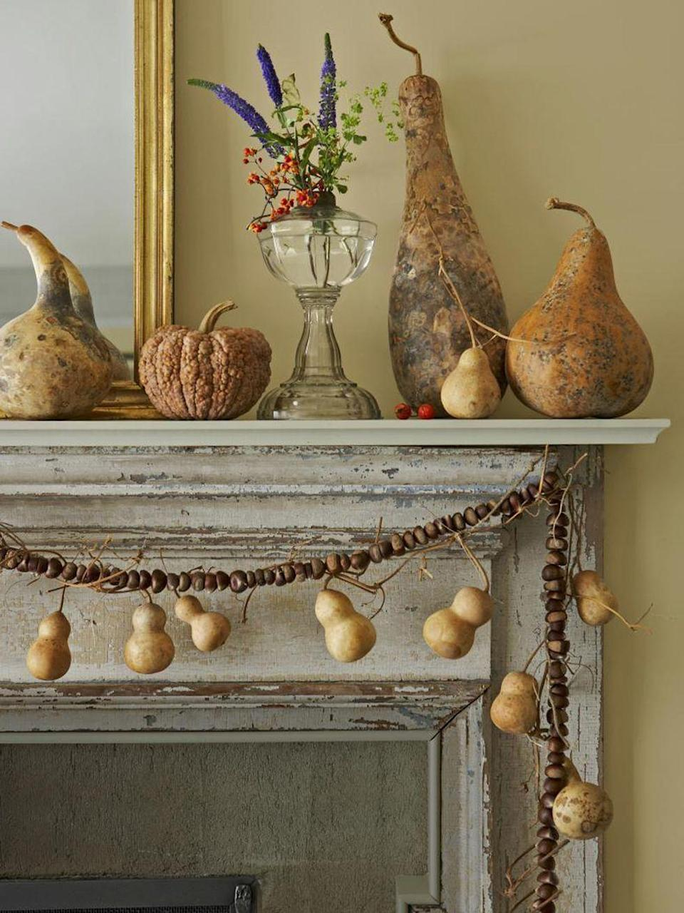 <p>Look no further than a mix of dried gourds, squash and a garland of chestnuts to fill your living room with autumn vibes.<br></p>