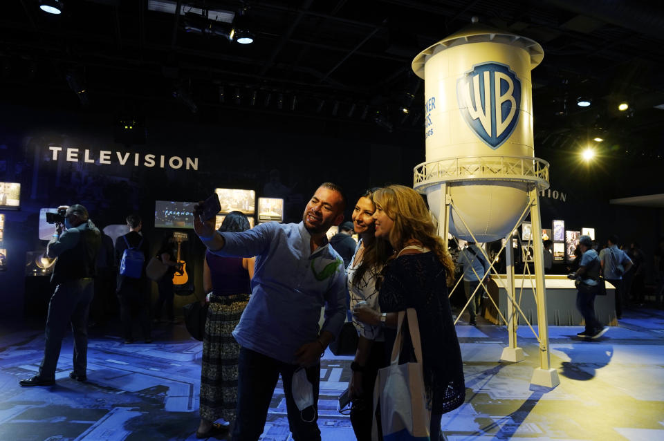 """Visitors shoot a selfie inside the """"Storytelling Showcase"""" at the Warner Bros. Studio Tour Hollywood media preview on June 24, 2021, in Burbank, Calif. (AP Photo/Chris Pizzello)"""