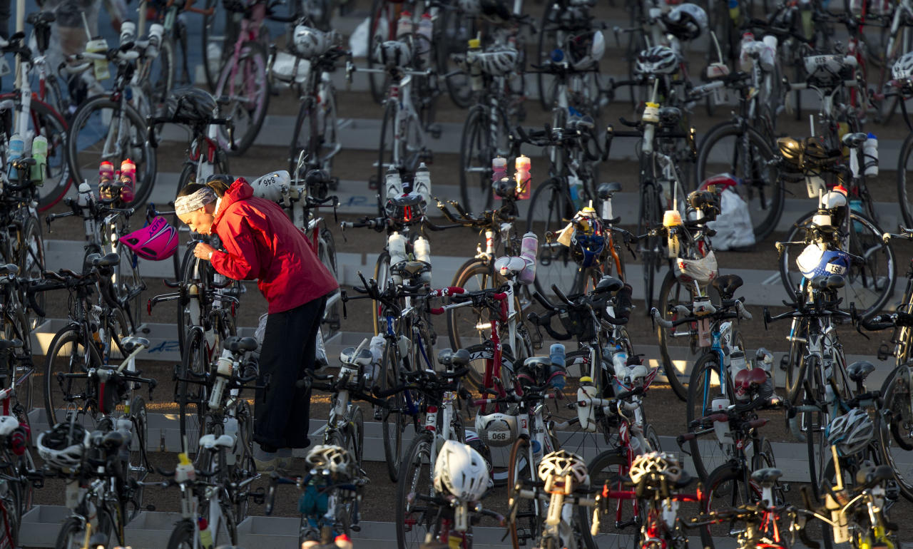 A triathlete prepares her bike for competition before the start of the International Triathlon Union Long Course Championships, Saturday, Nov. 5, 2011, in Las Vegas. (AP Photo/Julie Jacobson)
