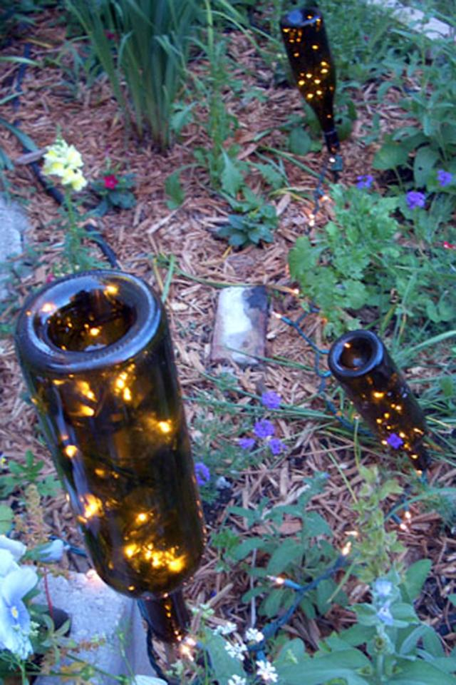 "<p>A few bottles, <a rel=""nofollow"" href=""http://www.countryliving.co.uk/homes-interiors/gardens/how-to/g78/fairy-lights-garden-ideas/""><strong>fairy lights</strong></a>, and stakes are all you need to create some magical ambiance in your garden. </p><p><strong>Get the tutorial at <a rel=""nofollow"" href=""http://more-organics.com/2011/07/05/easy-garden-lights/"">More Organics</a>.</strong></p>"