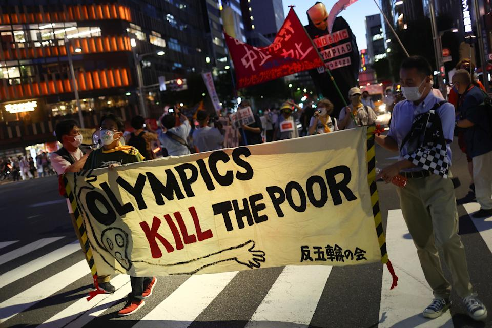 People protest against IOC president Thomas Bach's visit to Hiroshima, in Tokyo (REUTERS)