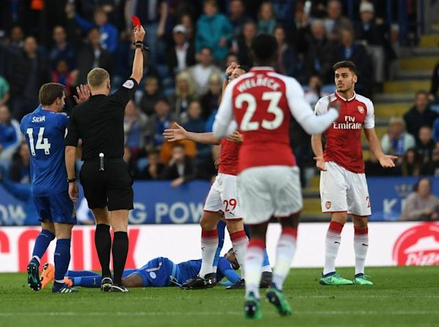Arsene Wenger rages at 'creative' and 'imaginative' refereeing as Arsenal lose at Leicester