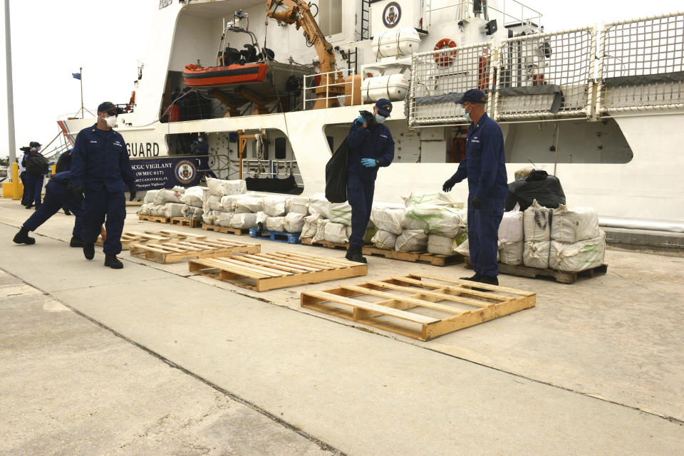 Crew members aboard the Coast Guard Cutter Vigilant stack seized cocaine at Coast Guard Base Miami Beach, Florida, in this photo taken June 12, 2015.  The crew of the Vigilant and the Coast Guard Cutter Bear interdicted the cocaine worth an estimated wholesale value of $10.9 million on May 22, 2015, according to a news release. Picture taken June 12, 2015.  REUTERS/U.S. Coast Guard/Petty Officer 3rd Class Mark Barney/Handout  THIS IMAGE HAS BEEN SUPPLIED BY A THIRD PARTY. IT IS DISTRIBUTED, EXACTLY AS RECEIVED BY REUTERS, AS A SERVICE TO CLIENTS. FOR EDITORIAL USE ONLY. NOT FOR SALE FOR MARKETING OR ADVERTISING CAMPAIGNS