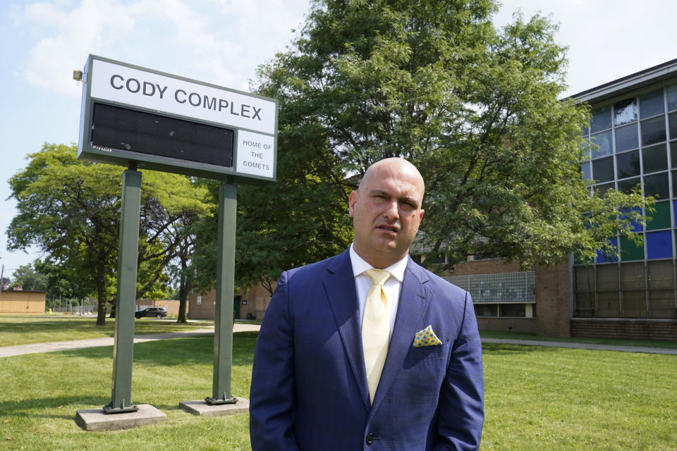 Dr. Nikolai Vitti, superintendent of Detroit Public Schools Community District, speaks during an interview outside Cody High School in Detroit on Friday, Aug. 20, 2021. In the wake of new federal pandemic funding, the district plans to add mental health services in dozens of schools, but it's being done through a contractor. Even the building improvements will only be temporary if the district does not get additional funding to maintain them, he says. (AP Photo/Carlos Osorio)
