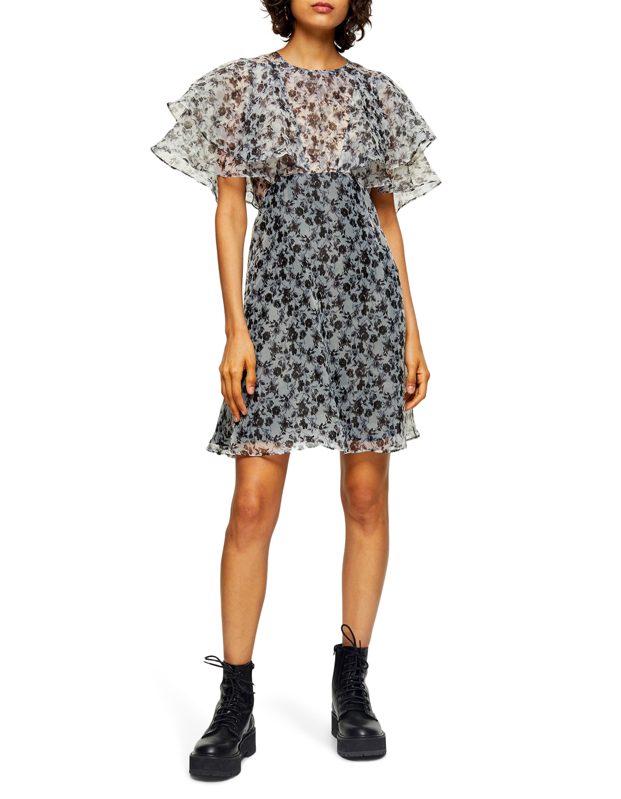 "Pair this frilly dress with <a href=""https://www.glamour.com/story/combat-boot-outfits?mbid=synd_yahoo_rss"" target=""_blank"">combat boots</a> and tights to hint at warmer days while still conquering those surprise storms the end of winter brings. (<em>Knocks on wood</em>) $95, Nordstrom. <a href=""https://shop.nordstrom.com/s/topshop-organza-floral-print-minidress/5497326/full"">Get it now!</a>"