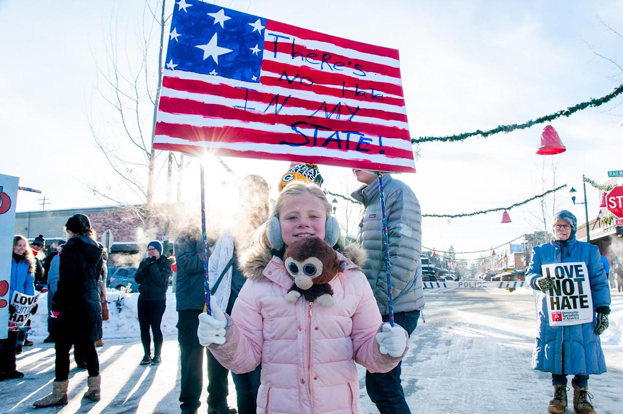 Hazel Ryan, 8, who traveled from Butte, Mont., holding a sign that she made for the event. (Photo: Lauren Grabelle)