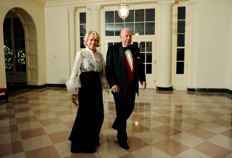 FILE PHOTO: Shultz arrives with his wife arrive for a state dinner in Washington