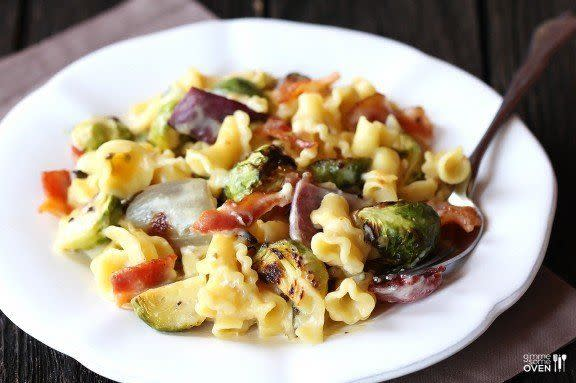 """<strong>Get the <a href=""""http://www.gimmesomeoven.com/brussels-sprouts-bacon-and-pepperjack-macaroni-and-cheese/"""" target=""""_blank"""">Roasted Brussels Sprouts, Bacon & Pepperjack Macaroni & Cheese recipe</a> from Gimme Some Oven</strong>"""