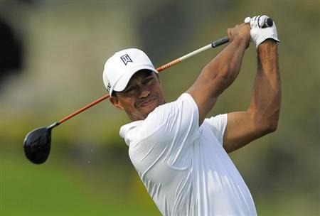 Tiger Woods watches his tee shot on the 16th hole during third round play in the Arnold Palmer Invitational PGA golf tournament in Orlando, Florida March 23, 2013. REUTERS/Scott Miller