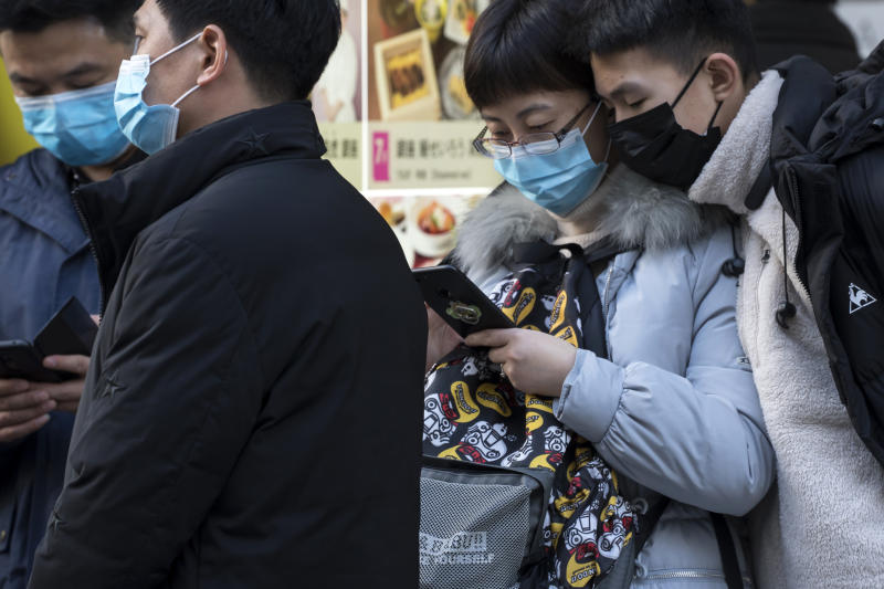 TOKYO, JAPAN - JANUARY 24: Chinese tourists wearing masks use smartphones in the Ginza shopping district on January 24, 2020 in Tokyo, Japan. While Japan is one of the most popular foreign travel destinations for Chinese tourists during the Lunar New Year holiday this year, Japan reported two cases of Wuhan coronavirus infections as the number of those who have died from the virus in China climbed to 25 on Friday and cases have been reported in other countries including the United States, Thailand, Taiwan, Vietnam, Singapore and South Korea. (Photo by Tomohiro Ohsumi/Getty Images)