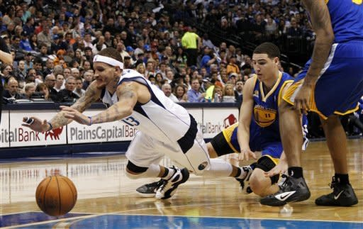 Dallas Mavericks' Delonte West, left, trips while driving to the basket on Golden State Warriors' Klay Thompson (11) in the first half of an NBA basketball game Friday, April 20, 2012, in Dallas. (AP Photo/Tony Gutierrez)