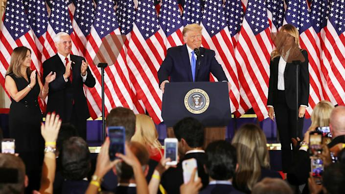 U.S. President Donald Trump speaks on election night in the East Room of the White House as First Lady Melania Trump, Vice President Mike Pence and Karen Pence look on in the early morning hours of November 04, 2020 in Washington, DC. (Chip Somodevilla/Getty Images)
