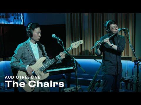"""<p>Taiwanese indie trio<a href=""""https://open.spotify.com/artist/4IlxI05VmVDx8ShdgKEnLK"""" rel=""""nofollow noopener"""" target=""""_blank"""" data-ylk=""""slk:The Chairs"""" class=""""link rapid-noclick-resp""""> The Chairs</a> is one of the hottest acts in Taiwan right now. Comprised of 27-year-olds Jing Chiu (lead vocals, guitar, keyboard), Zhong Chen (vocals, guitar), and Benson Sun (bass, backing vocals), The Chairs write and perform retro-style songs in both English and Chinese that span a variety of genres, including psychedelic pop, folk, rock, and retro pop. The band was nominated for multiple awards at the Golden Indie Music Awards in Taiwan in 2016 and 2019 and won the Best Vocal Group Award at the 2019 Golden Melody Awards (the equivalent of the Grammy Awards in the Chinese-speaking world.)</p><p>The members first met each other in high school and officially formed their band in college, calling themselves The Chairs in order to enter singing competitions because the room they were in at the time had only guitars and, well, chairs. Now with three albums under their belt, they admit they're still learning about the music business in Asia and other parts of the world. Their first U.S. tour was cancelled when the pandemic broke out in New York. """"It was the toughest time for us,"""" says Chiu. On the flip side, they've been able to spend more time making their new album while in quarantine and plan to release it later this year. """"Hopefully when the pandemic ends, we can go to places we've never been to to do live shows,"""" adds Chiu.</p><p><a class=""""link rapid-noclick-resp"""" href=""""https://www.instagram.com/chairchairmusic/"""" rel=""""nofollow noopener"""" target=""""_blank"""" data-ylk=""""slk:Follow on Instagram"""">Follow on Instagram</a></p><p><a href=""""https://www.youtube.com/watch?v=mItR9mK54rQ"""" rel=""""nofollow noopener"""" target=""""_blank"""" data-ylk=""""slk:See the original post on Youtube"""" class=""""link rapid-noclick-resp"""">See the original post on Youtube</a></p>"""