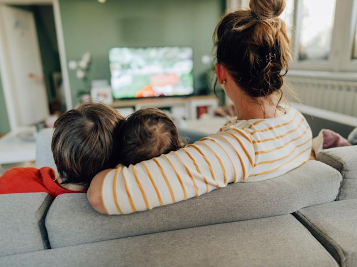 family kids watching tv movie at home streaming