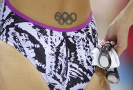 U.S. swimmer Dana Vollmer sports a tattoo of the Olympic rings during a practice session at the Aquatics Center at Olympic park ahead of the the 2012 Summer Olympics, Thursday, July 26, 2012, in London. (AP Photo/Michael Sohn)