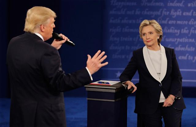 <p>Democratic presidential nominee Hillary Clinton listens to Republican presidential nominee Donald Trump during the second presidential debate at Washington University in St. Louis, Sunday, Oct. 9, 2016. (Photo: John Locher/AP) </p>