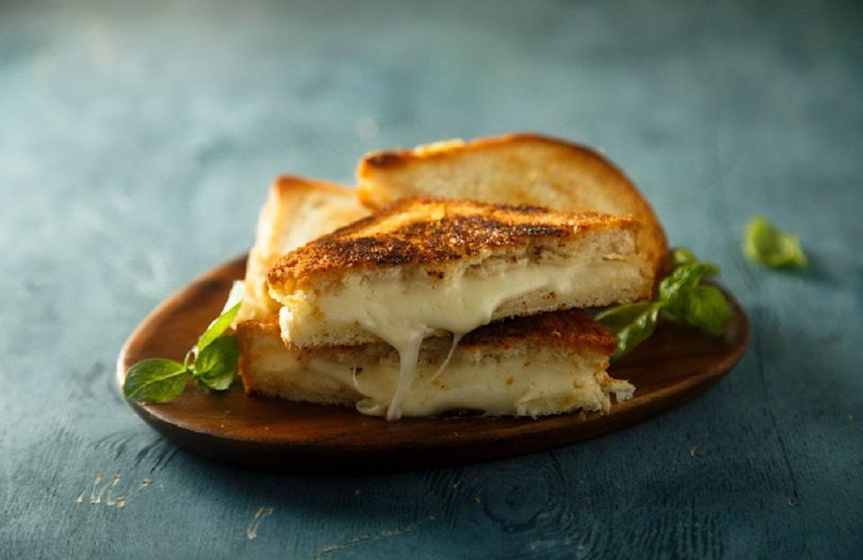 """<p>If you're missing Panera Bread's old fontina grilled cheese, we've found a way to recreate the ooey-gooey sandwich from home. All you need is three cheeses, some butter and mayonnaise to ensure the bread crisps up just right. When it's done, dunk the sandwich in some Panera copycat <a href=""""https://www.thedailymeal.com/cook/broccoli-cheese-recipes-casseroles-soups-eggs?referrer=yahoo&category=beauty_food&include_utm=1&utm_medium=referral&utm_source=yahoo&utm_campaign=feed"""" rel=""""nofollow noopener"""" target=""""_blank"""" data-ylk=""""slk:broccoli cheddar soup"""" class=""""link rapid-noclick-resp"""">broccoli cheddar soup</a>.</p> <p><a href=""""https://www.thedailymeal.com/panera-copycat-grilled-cheese?referrer=yahoo&category=beauty_food&include_utm=1&utm_medium=referral&utm_source=yahoo&utm_campaign=feed"""" rel=""""nofollow noopener"""" target=""""_blank"""" data-ylk=""""slk:For the Fontina Grilled Cheese recipe, click here."""" class=""""link rapid-noclick-resp"""">For the Fontina Grilled Cheese recipe, click here.</a></p>"""