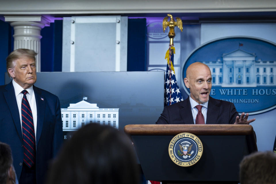 President Donald Trump looks on as FDA Commissioner Stephen Hahn addresses the media during a press conference at the White Houseon August 23, 2020 in Washington, DC. (Photo by Pete Marovich/Getty Images)