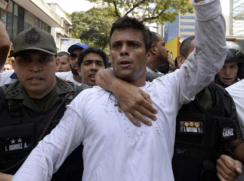 Leopoldo Lopez is escorted by the National Guard after turning himself in on February 18, 2014 (AFP Photo/Juan Barreto)