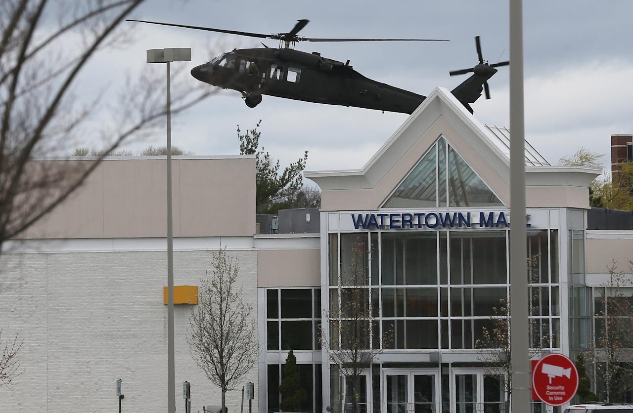WATERTOWN, MA - APRIL 19: A U.S. military helicopter lands behind Watertown Mall as law enforcement agencies search for 19-year-old bombing suspect Dzhokhar A. Tsarnaev on April 19, 2013 in Watertown, Massachusetts. After a car chase and shoot out with police, one suspect in the Boston Marathon bombing, Tamerlan Tsarnaev, 26, was shot and killed by police early morning April 19, and a manhunt is underway for his brother and second suspect, 19-year-old suspect Dzhokhar A. Tsarnaev. The two men, reportedly Chechen of origin, are suspects in the bombings at the Boston Marathon on April 15, that killed three people and wounded at least 170. (Photo by Mario Tama/Getty Images)