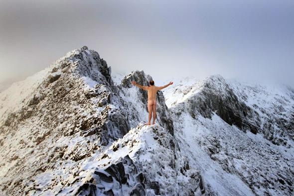 Naked Dan Arkle scales icy mountain in Wales
