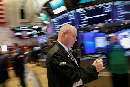 FILE PHOTO: Traders work on the floor of the New York Stock Exchange (NYSE) in New York, U.S., April 18, 2018. REUTERS/Brendan McDermid