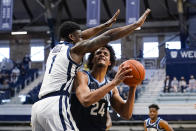 Villanova forward Jeremiah Robinson-Earl (24) looks to shoot over Butler guard Bo Hodges (1) in the first half of an NCAA college basketball game in Indianapolis, Sunday, Feb. 28, 2021. (AP Photo/Michael Conroy)