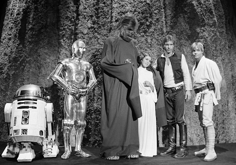"Kenny Baker, Anthony Daniels, Peter Mayhew, Carrie Fisher, Harrison Ford, and Mark Hamill during the filming of the CBS-TV special ""The Star Wars Holiday"" in Los Angeles on Nov. 13, 1978"