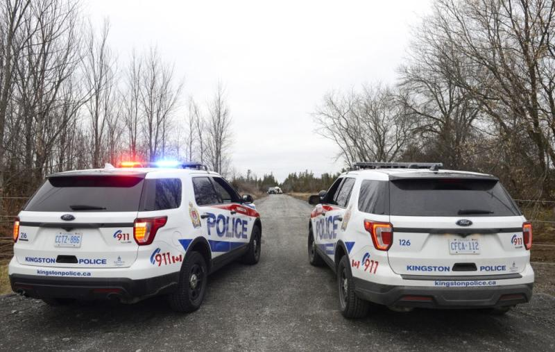 Two Kingston Police cars block a road leading to the site of a fatal plane crash in Kingston, Ontario, in Canada. | Sean Kilpatrick/The Canadian Press via AP