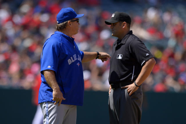 Toronto Blue Jays manager John Gibbons, left, argues with second base umpire Dan Iassogna after Edwin Encarnacion was forced out at second during the eighth inning of their baseball game against the Los Angeles Angels, Sunday, Aug. 4, 2013, in Anaheim, Calif. (AP Photo/Mark J. Terrill)