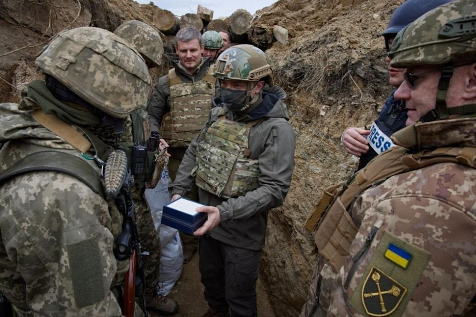 Ukrainian President Volodymyr Zelensky visits troops at a front in Donbass, Ukraine on April 8.