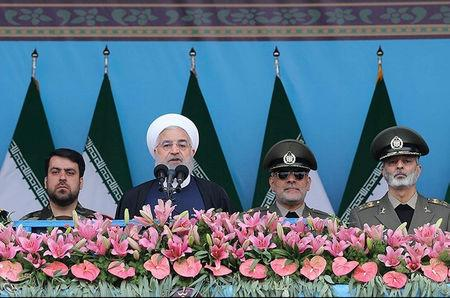FILE PHOTO: Iranian President Hassan Rouhani delivers a speech during the ceremony of the National Army Day parade in Tehran, Iran April 18, 2019. Tasnim News Agency/via REUTERS ATTENTION EDITORS - THIS PICTURE WAS PROVIDED BY A THIRD PARTY - /File Photo