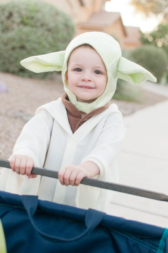 """<p>Is there anything cuter than a little dressed up as Yoda?</p><p><strong>Get the tutorial at <a href=""""https://snaphappymom.com/star-wars-themed-halloween-costumes/"""" rel=""""nofollow noopener"""" target=""""_blank"""" data-ylk=""""slk:Snap Happy Mom"""" class=""""link rapid-noclick-resp"""">Snap Happy Mom</a>.</strong></p><p><a class=""""link rapid-noclick-resp"""" href=""""https://www.amazon.com/Leveret-Pajamas-Girls-Pajama-Cotton/dp/B07HFH16FC/ref=asc_df_B07HFH16FC/?tag=syn-yahoo-20&ascsubtag=%5Bartid%7C10050.g.21287723%5Bsrc%7Cyahoo-us"""" rel=""""nofollow noopener"""" target=""""_blank"""" data-ylk=""""slk:SHOP PAJAMAS"""">SHOP PAJAMAS</a><br></p>"""