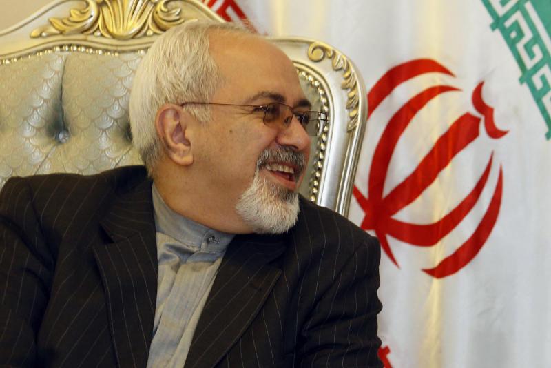 Iran's Foreign Minister Mohammed Javad Zarif speaks to his Iraqi counterpart Hoshyar Zebari, not seen, after arriving at the Baghdad International Airport, Iraq, Sunday, Sept. 8, 2013. Iran's new foreign minister has arrived in neighboring Iraq on his first trip abroad since taking office. (AP Photo/Saad Shalash, Pool)