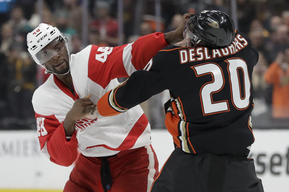 Detroit Red Wings' Givani Smith, left, fights with Anaheim Ducks left wing Nicolas Deslauriers during the first period of an NHL hockey game in Anaheim, Calif., Tuesday, Nov. 12, 2019. (AP Photo/Chris Carlson)