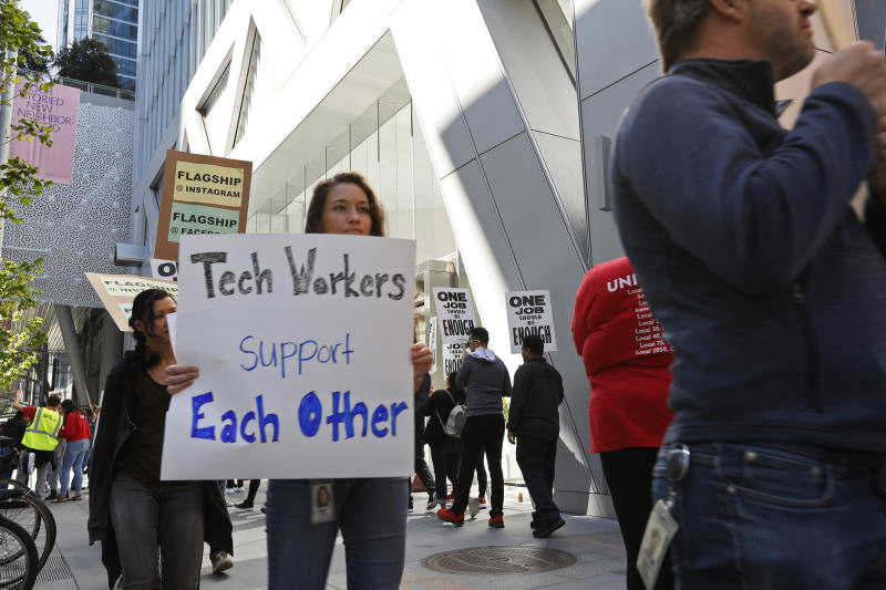 In this photo taken July 16, 2019, tech workers march to support Facebook's cafeteria workers, who were rallying for a new contract with their company Flaghship in San Francisco. Tech workers are speaking out on issues of immigration, the environment, sexual misconduct and military warfare like never before. Google, Amazon and Microsoft employees protest against how their work is used by the government. Through petitions and collective actions, others push for better internal policies, greener practices and better work conditions for contractors. (AP Photo/Samantha Maldonado)
