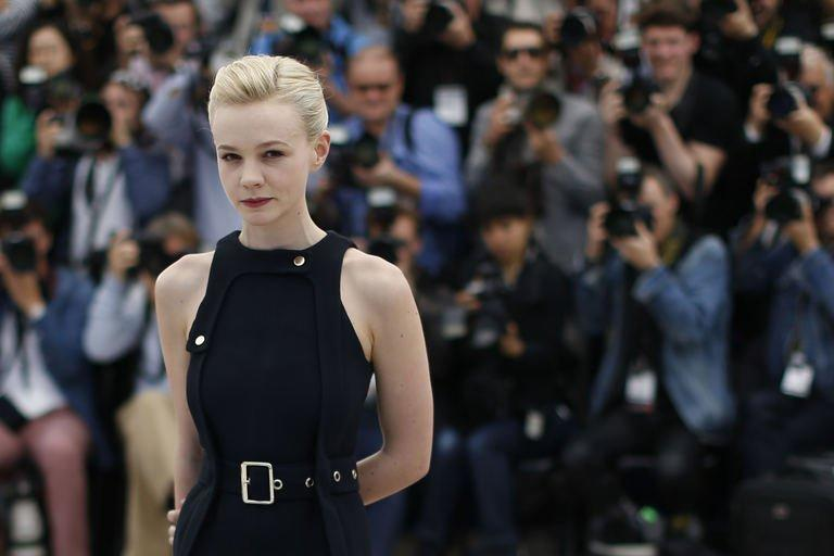 """British actress Carey Mulligan poses on May 19, 2013 during a photocall for the film """"Inside Llewyn Davis"""" at the Cannes Film Festival. The """"Great Gatsby"""" actress Mulligan traded in her Tiffany jewellery and Prada-designed flapper dresses for polo necks and duffel coats in her second star turn at the festival in the Coen brothers' eagerly anticipated film"""