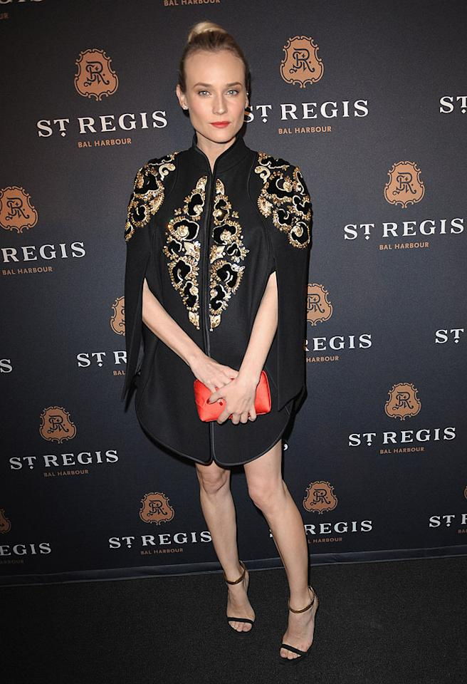 """Inglourious Basterds"" beauty Diane Kruger is a fashion trailblazer, but we're not too sure about the bedazzled Jason Wu cape dress she wore to the St. Regis Bal Harbour Resort opening. It's definitely daring (which is a plus), but it also seems unshapely ... and drafty. (3/17/2012)"