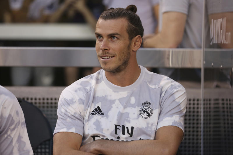 Real Madrid forward Gareth Bale sits on the bench before the first half of an International Champions Cup soccer match against Atletico Madrid, Friday, July 26, 2019, in East Rutherford, N.J. Atletico Madrid won 7-3. (AP Photo/Steve Luciano)